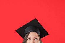 Female Graduating Student On Color Background