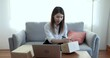 Asian woman working from home, SME business owner, Online marketing and delivery.