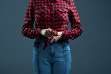 Girl In A Red Plaid Shirt On A Gray Background