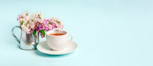Beautiful Minimalist Background With Floral Composition And Tea Mug, Copy Space On Light Blue Backround