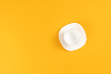 Empty Coffee Or Tea Cup Isolated On Yellow. Top View. Copy Space