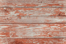 Wooden Red Brown Painted Wall. Old Shabby Rustic Planks Background. Vintage Wood Texture.