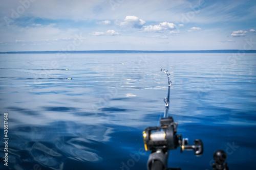 Obraz na plátně Lake trolling in summer scenery