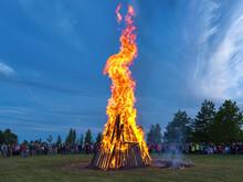 Kuressaare, Saaremaa Island, Estonia. Traditional Large Bonfire To Celebrate The Jaanipaev (Jaan's Day). This Estonian Public Holiday Corresponds To The English Midsummer Day.