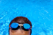 Swimming Goggles Of A Sportswoman In A Pool In Summer.