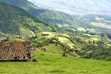 Derelict Barn With A Red Tile Roof Surrounded By Mountains On The Road To Lago Mojando, Outside Of Otavalo, Ecuador