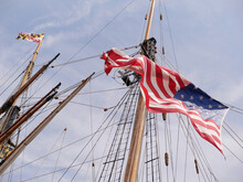 American Flag Flying From A Ship Mast On A Beautiful Summer Day