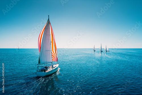 Billede på lærred Regatta sailing ship yachts with white sails at opened sea