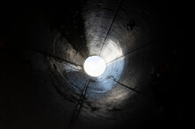 Abstract Black Tunnel Made With Round Pipe. Concept Of Exit Or Endless. A Light In The End Of A Tunnel.