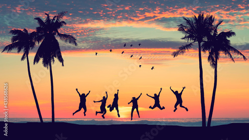 Fotografiet Silhouette happy friends jumping on sunset sky at tropical beach with palm tree and birds flying abstract background