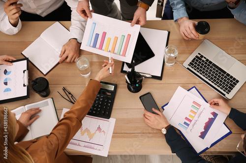 Businesspeople having meeting in office, top view Fototapeta