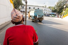 Rikshaw Driver On A Road Wearing Red Shirt.
