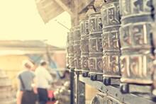 Many Prayer Wheels - Spinning Them For Good Fortune.