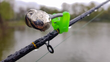 Silver Fishing Bells Are Worn On A Fishing Rod While Fishing. Bite-call Signal, At The Tip Of The Rod. A Bite Alarm Will Alert You To A Bite. Fishing Tackle Close-up.