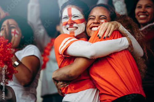 Female soccer fans celebrating a goal at match Poster Mural XXL