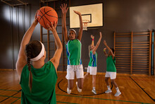 Diverse Female Basketball Team Practicing Shooting With Ball