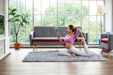 Asian Woman Post Yoga One Leg Pigeon For Practicing And Reading Magazine