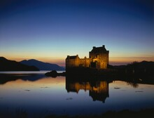 Great Britain, Scotland, Eilean Donan Castle With, Loch Duich In The Evening, Evening Atmosphere, Castle, Lake, Hill, Water, Castle Lighting, Outside,