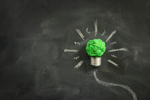 Concept Image If Green Crumpled Paper Lightbulb, Symbol Of Scr, Innovation And Eco Friendly Business