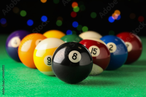 Wallpaper Mural Many colorful billiard balls on green table, closeup