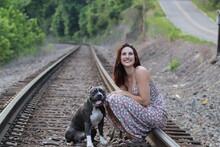 Beautiful Woman With Pitbull Dog On Train Tracks