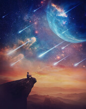 Lone Person On The Peak Of A Cliff Admiring A Wonderful Space Phenomenon. Fantastic Scenery With Falling Stars And Colorful Nebulas Above The Sunset. Inspirational Imaginary Landscape, Mystery View