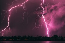 Thunderstorms And Intense Lightning In The Night Sky