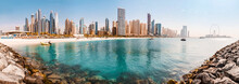 Wide Panorama Of The Persian Gulf With Sandy Beach And Bluewaters Island With The Worlds Famous Largest Ferris Wheel Dubai Eye And Numerous Skyscrapers With Hotels And Residences