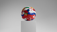 National Flag Themed Football On A Plinth Against A White Background.