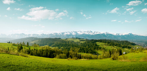 Panorama of snow-capped Tatry Mountains on Podhale in Poland