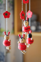 Wooden Hanging Ladybug Figurines With Red Flowers.