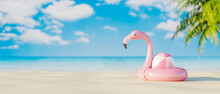 Pink Flamingo Life Belt And Rubber Ball On The Sand Beach. Travel On Summer Vacation Concept 3d Render 3d Illustration