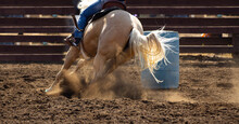 Horses And Cowboys At The Rodeo With Fast Moving Racing And Dirt Flying.