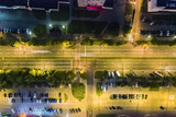 night cityscape with street and parking lot with parked cars. aerial top view.