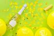 Leinwandbild Motiv Bottle of champagne with balloons and confetti on color background