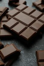 Tasty Chocolate Bars On Black Smokey Background