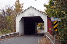 Erwinna White And Red Wooden Covered Bridge In Early Fall Daylight