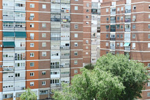 Buildings In Suburb Neighbourhood Occupied Mostly By Elderly Residents. Barrio Del Pilar District, Place With The Biggest Density Of Occupation In Europe. Cheap, Poor Constructions In Madrid, Spain