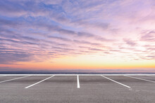 Empty Parking Lot Against Beautiful Sunset Sky.