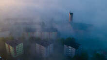 Top View Of The City In Fog And Smog. Pictures From The Drone.