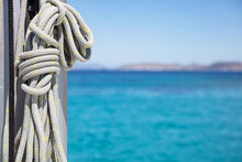 Yachting Ropes On The Sailing Boat Mast, Blur Sea Water Background..