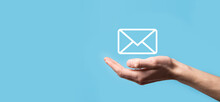 Male Hand Holding Letter Icon,email Icons .Contact Us By Newsletter Email And Protect Your Personal Information From Spam Mail. Customer Service Call Center Contact Us.Email Marketing And Newsletter