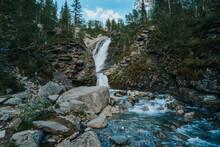 Beautiful Mountain Waterfall Among Rocks In Polar Summer In Khibiny Mountains. Mountain Landscape In Kola Peninsula, Arctic