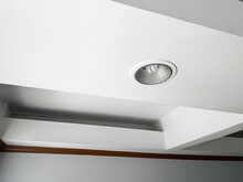Compact-fluorescent (CFL) Bulbs Installed On The White Ceiling.