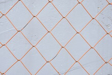オレンジ色のフェンス