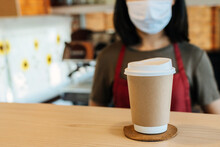 Hot Black Coffee Cup On Counter With Waitress Staff Wearing Protection Face Mask On Background In Cafe Shop, Food Delivery, Cafe Restaurant, Takeaway Food, Small Business Owner, Food And Drink Concept