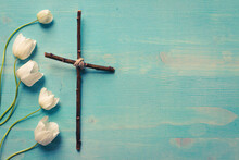 Christian Cross With White Flowers On Blue Wood Background