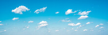 Panorama Sky And Clouds. White Cumulus Clouds On Clear Blue Sky Background Closeup, Overcast Skies Backdrop, Fluffy Cloud Texture, Beautiful Sunny Cloudscape Heaven