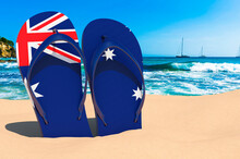 Flip Flops With Australian Flag On The Beach. Australia Resorts, Vacation, Tours, Travel Packages Concept. 3D Rendering