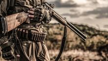 Hunting Period, Autumn Season. Male With A Gun. Hunter With A Backpack And A Hunting Gun. A Hunter With A Hunting Gun And Hunting Form To Hunt